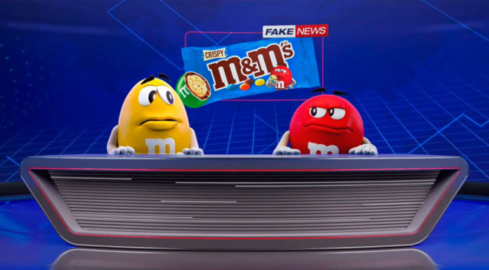 Vermelho e Amarelo em um telejornal mostrando que o M&M's Crispy é fake news.