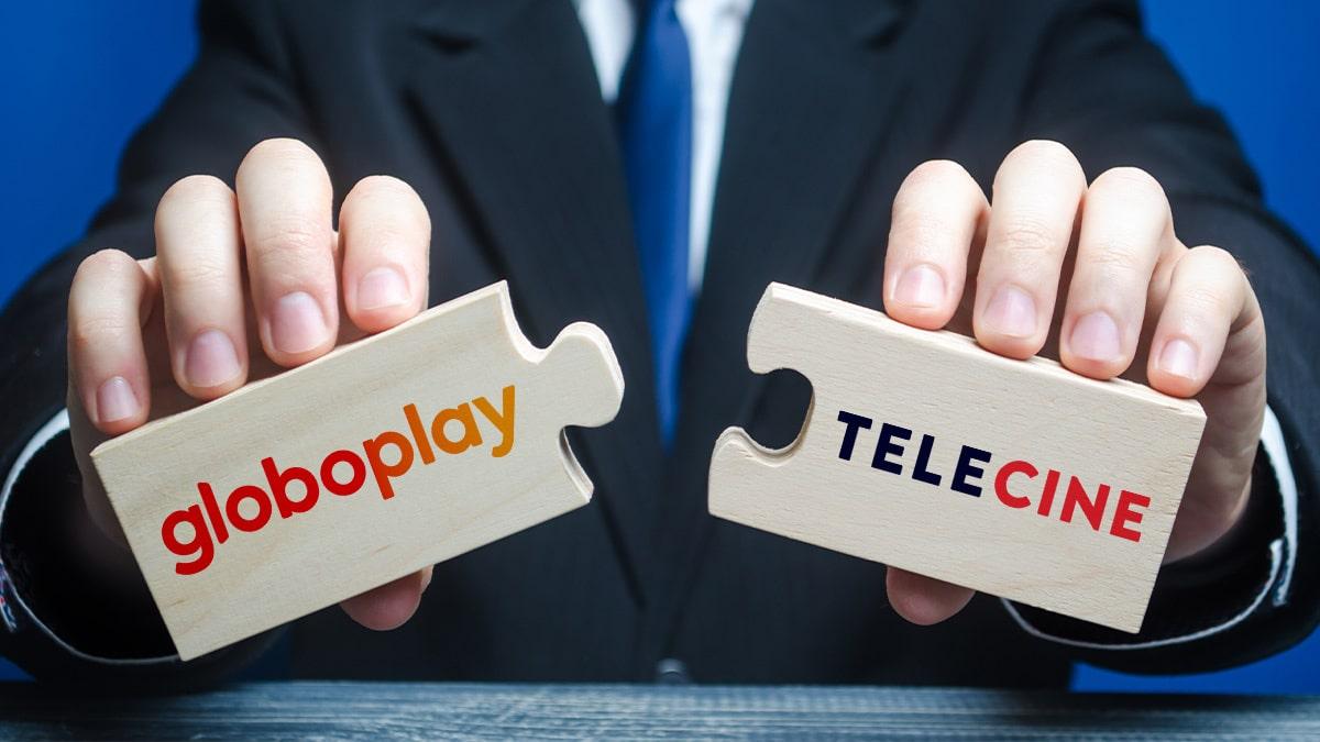 A foto apresenta um close na mão de um executivo segurando duas peças de um quebra-cabeça que se encaixam perfeitamente, em cada uma delas têm o logo do Globoplay e no outro do Telecine.